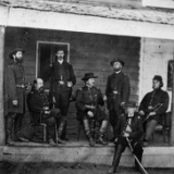 Gen. Alexander McCook and staff posed on porch near Washington, D.C.